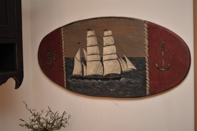 Antique style ship board with nautical symbols