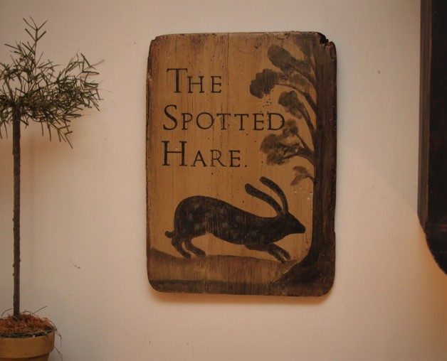 The Spotted Hare on old piece of wood.