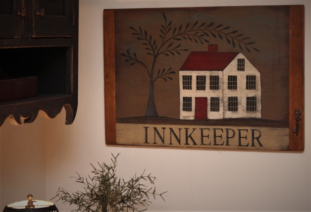 Innkeeper Sign with key on old breadboard