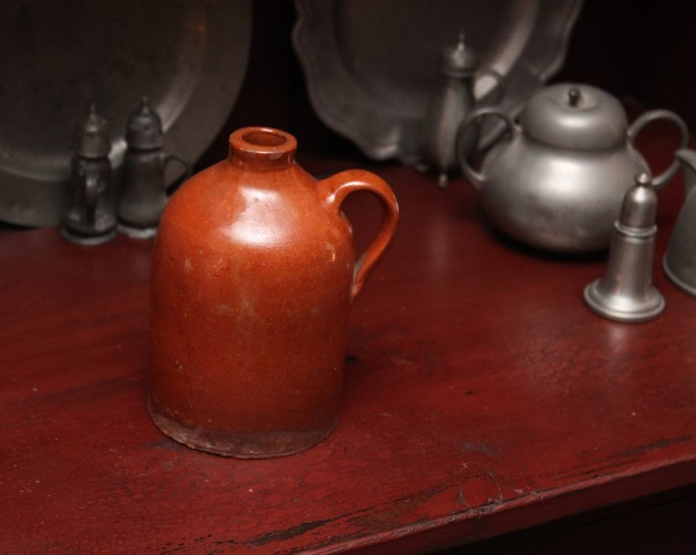 Early 1900's small redware jug