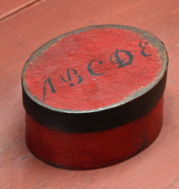 Red ABCDE oval box