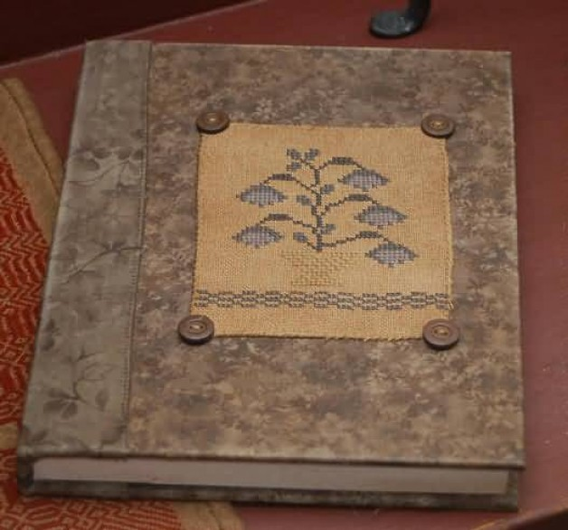 Large blue sampler book with buttons