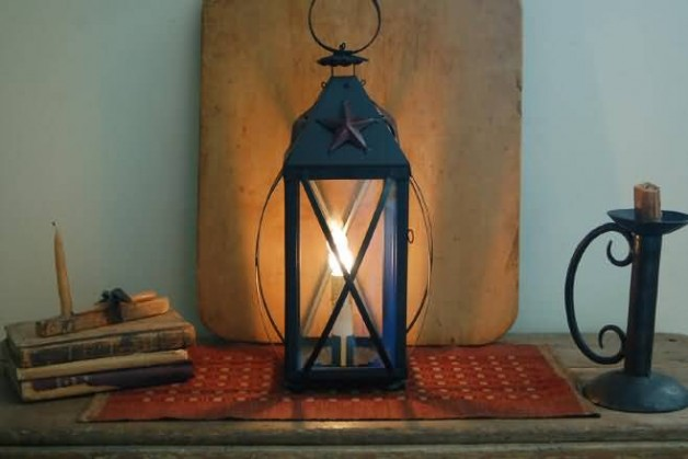 Electric liberty lantern with red star.