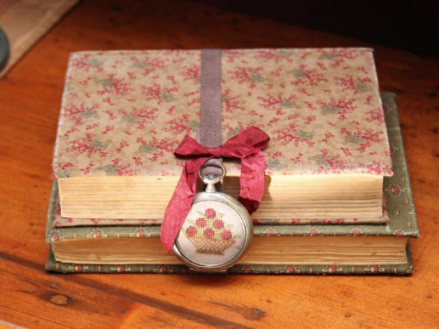 Fabric covered books with hand stitched antique watch