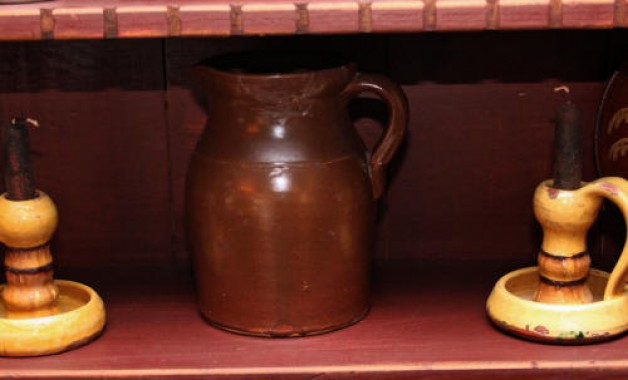 Antique pitcher with repair