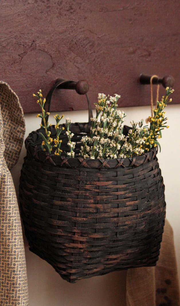 Black reproduction basket with flowers