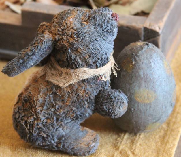 Grungy old bunny with blue egg