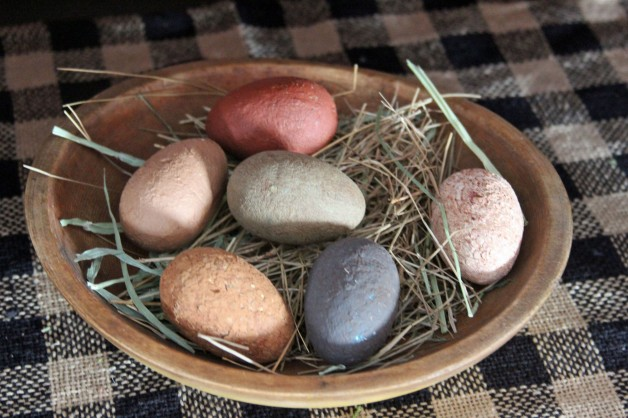 Set of six primitive eggs with grass