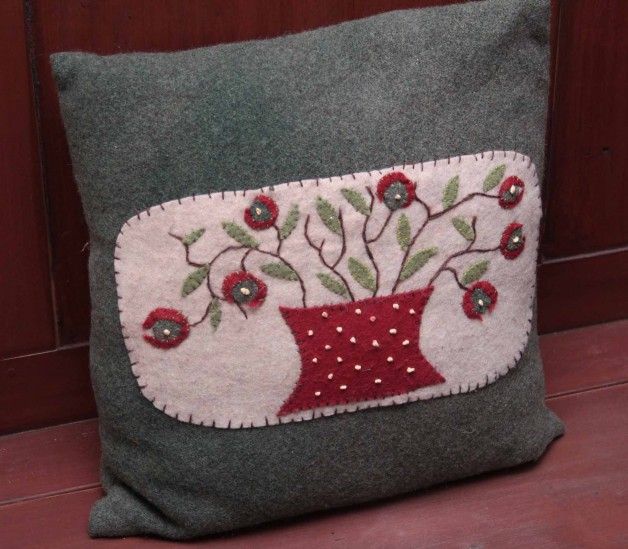 Wool pillow with applique