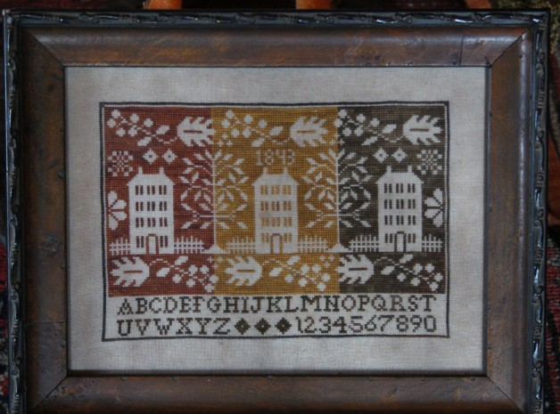 Coverlet sampler framed