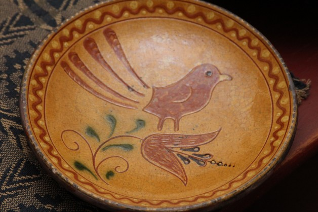 Red ware plate Schooner bird