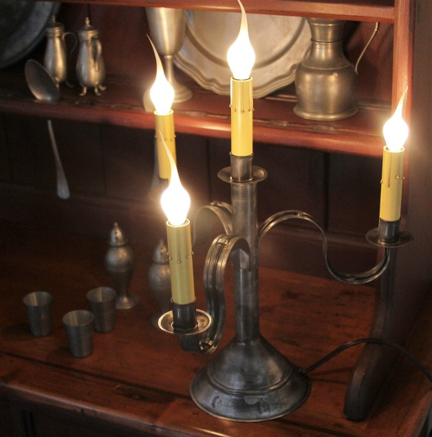 Four light aged tin candelabra