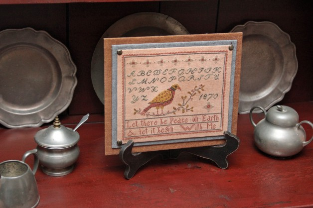 Bird sampler with easel