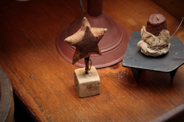 Brown star on antique wooden block