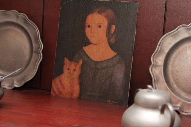 Girl with calico cat