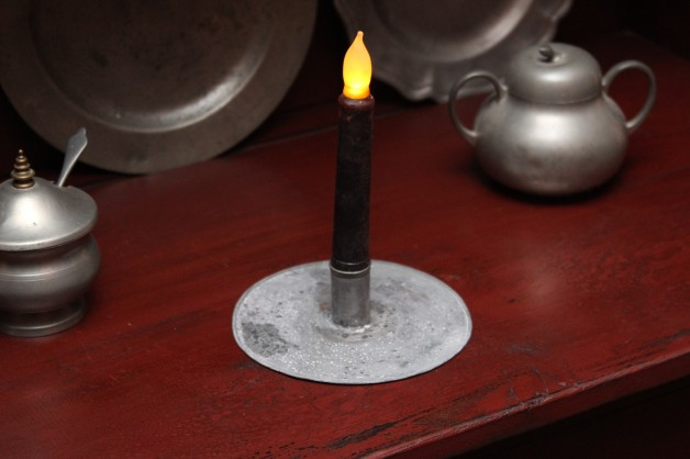 Grungy round aged tin candle holder