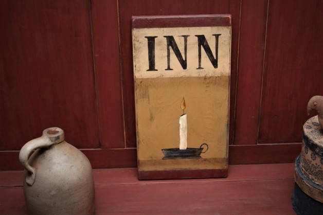 Inn with colonial candle