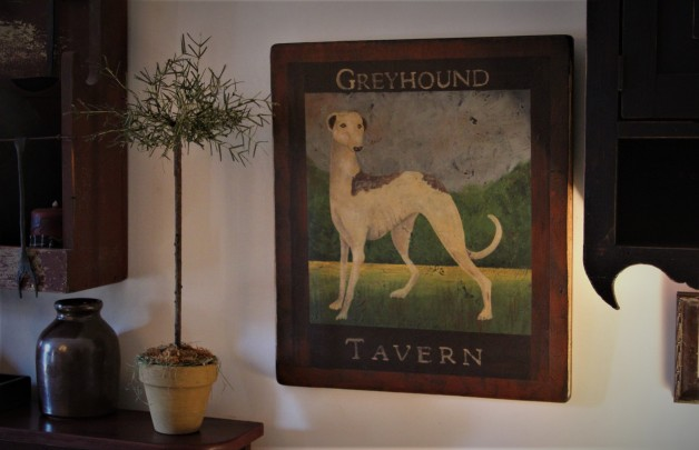 Antique Greyhound Tavern design sign on board